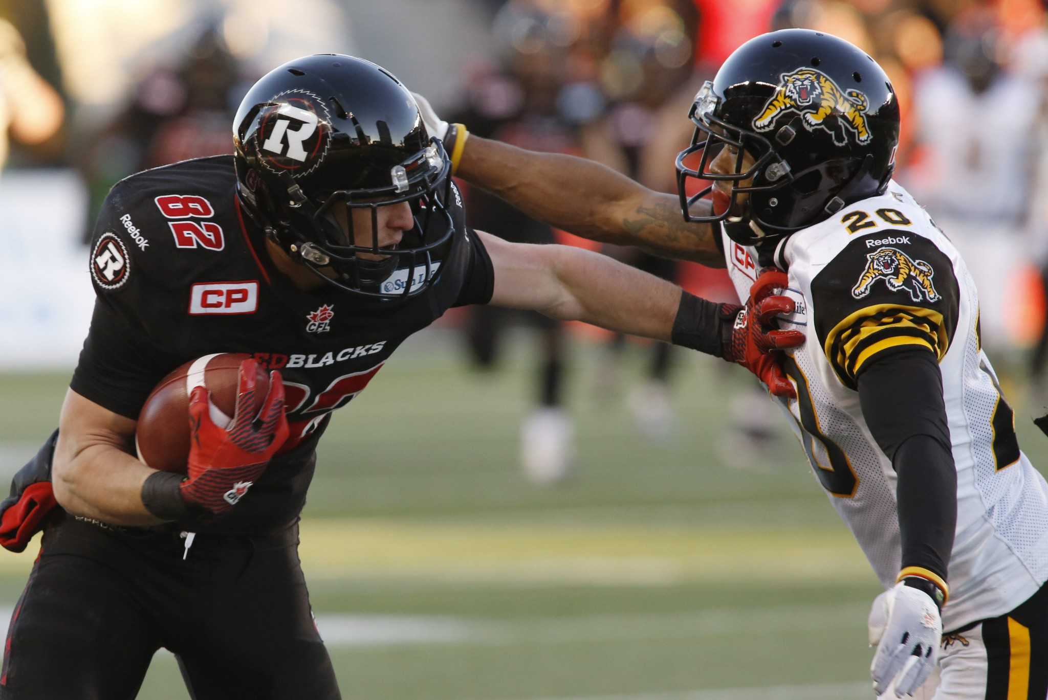 The Ottawa Redblacks Greg Ellingson fends off the Hamilton Tiger-Cats Emanuel Davis as he runs for the game winning touchdown during fourth quarter eastern final CFL action in Ottawa on Saturday, November 22, 2015. (CFL PHOTO - Patrick Doyle)