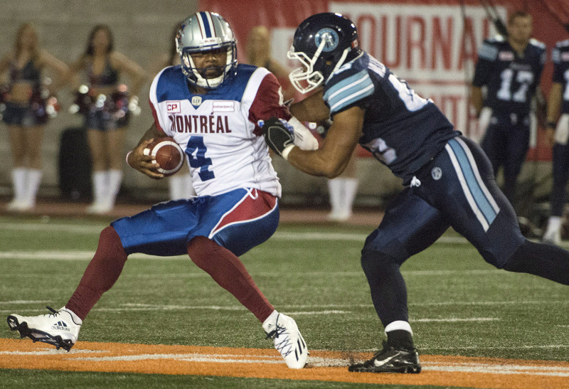 Toronto Argonauts' Trevardo Williams defends against Montreal Alouettes' Tajh Boyd during second half CFL action in Montreal on Friday, June 17, 2016. THE CANADIAN PRESS/Peter McCabe