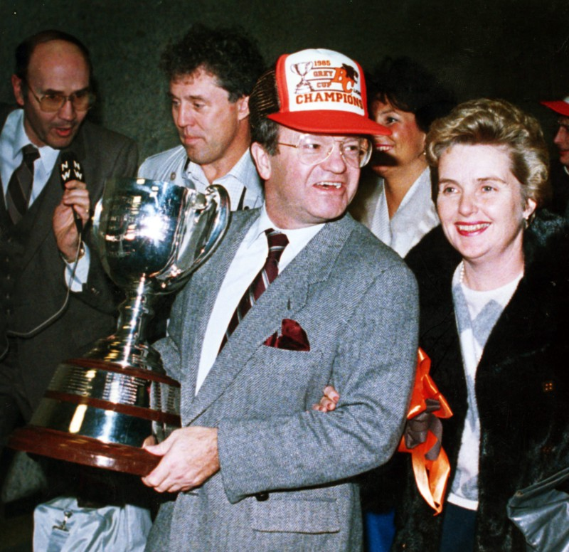B.C. Lions general manager Bob Ackles and his wife Kay, walk with the Grey Cup at the Vancouver International Airpost on Nov. 25, 1985. The Canadian Press/Chuck Stoody