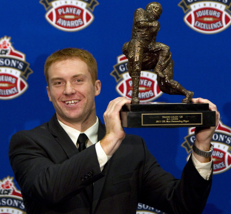 B.C. Lions quarterback Travis Lulay holds his award for the CFL Outstanding PlayerThursday November 24, 2011 in Vancouver. The B.C. Lions will face the Winnipeg Blue Bombers in the 99th Grey Cup CFL football final Sunday. THE CANADIAN PRESS/Jonathan Hayward