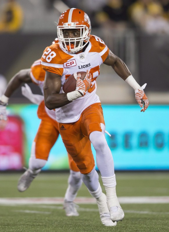 BC Lions' Anthony Thompson returns a fumble against the Hamilton Tiger Cats in during CFL football action at Tim Hortons Field in Hamilton on Friday July 1, 2016.THE CANADIAN PRESS/ Geoff Robins