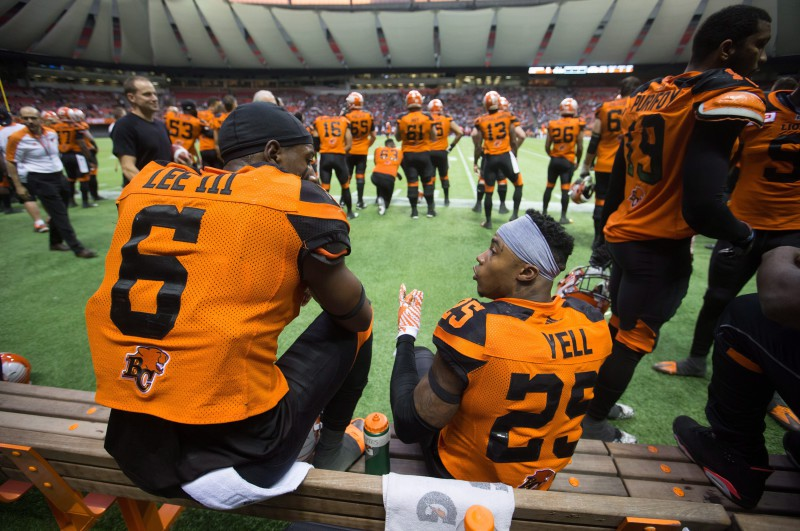 B.C. Lions' T.J. Lee, left, and Ronnie Yell talk while sitting on the bench during the second half of a pre-season CFL football game against the Calgary Stampeders in Vancouver, B.C., on Friday June 17, 2016. THE CANADIAN PRESS/Darryl Dyck