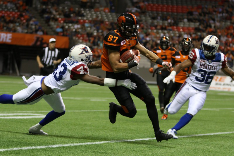 BC Lions' Marco Iannuzzi finds an opening as Montreal Alouettes' Dominique Termansen misses the tackle during the first half of CFL action in Vancouver, B.C., on Friday, Sept 9, 2016. (CFL PHOTO Ð Chad Hipolito)