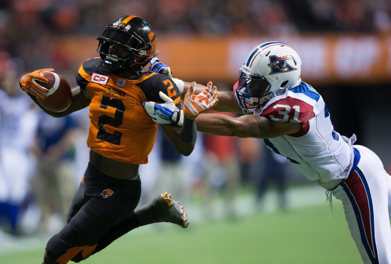B.C. Lions' Chris Rainey, left, is brought down by Montreal Alouettes' Winston Venable, who was penalized for an illegal tackle, as he tries to run the ball into the end zone during the second half of a CFL football game in Vancouver, B.C., on Friday September 9, 2016. THE CANADIAN PRESS/Darryl Dyck