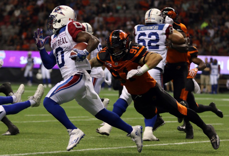 Montreal Alouettes' Stefan Logan avoids tackle from BC Lions' Cameron Ontko during the second half of CFL action in Vancouver, B.C., on Friday, September 9, 2016. Lions won 38-27. (CFL PHOTO Ð Chad Hipolito)