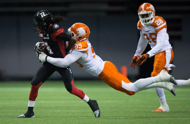 B.C. Lions' Darius Allen, right, dives to tackle Ottawa Redblacks' Jamill Smith, who fumbled the ball on the play leading to a turnover, during the first half of a CFL football game in Vancouver, B.C., on Saturday October 1, 2016. THE CANADIAN PRESS/Darryl Dyck