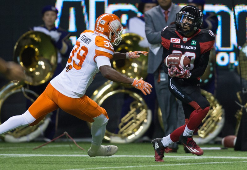 Ottawa Redblacks' Chris Williams, right, makes a reception before running it for a touchdown as B.C. Lions' Chandler Fenner defends during the first half of a CFL football game in Vancouver, B.C., on Saturday October 1, 2016. THE CANADIAN PRESS/Darryl Dyck