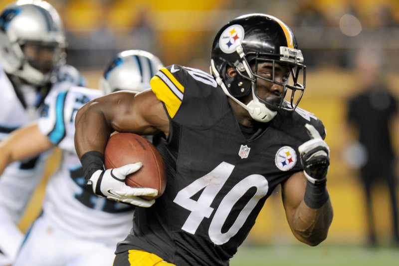 Pittsburgh Steelers running back Josh Harris (40) runs away from Carolina Panthers defensive back Colin Jones (42) in the fourth quarter of a NFL preseason football game on Thursday, Aug. 28, 2014 in Pittsburgh. (AP Photo/Don Wright)