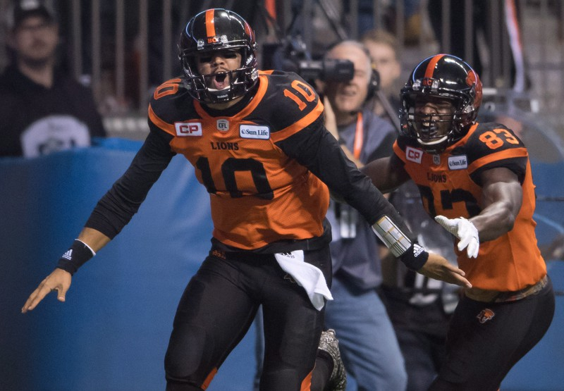 B.C. Lions' quarterback Jonathon Jennings, left, and Stephen Adekolu celebrate Jennings touchdown that proved to be the game winning score against the Winnipeg Blue Bombers during second half western semifinal CFL football action in Vancouver, B.C., on Sunday November 13, 2016. THE CANADIAN PRESS/Darryl Dyck