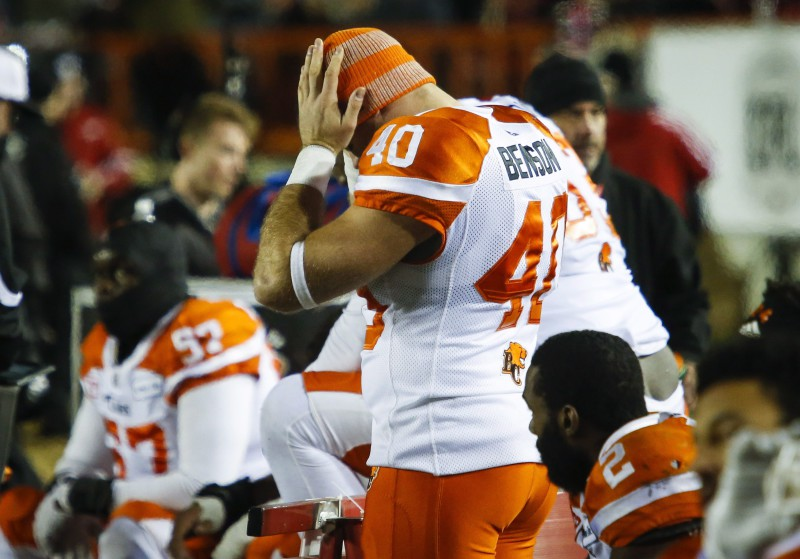 B.C. Lions' Mike Benson, centre, holds his head as the team loses to the Calgary Stampeders during the finals minutes of CFL Western Final football action in Calgary, Sunday, Nov. 20, 2016.THE CANADIAN PRESS/Jeff McIntosh