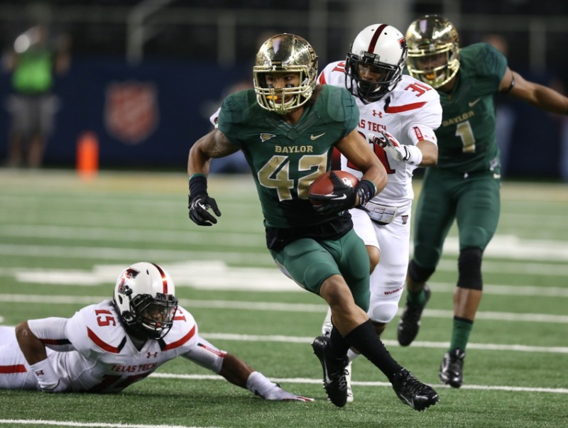 Nov 16, 2013; Arlington, TX, USA; Baylor Bears receiver Levi Norwood (42) runs for a touchdown after a catch in the second quarter against the Texas Tech Red Raiders at AT&T Stadium. Mandatory Credit: Matthew Emmons-USA TODAY Sports
