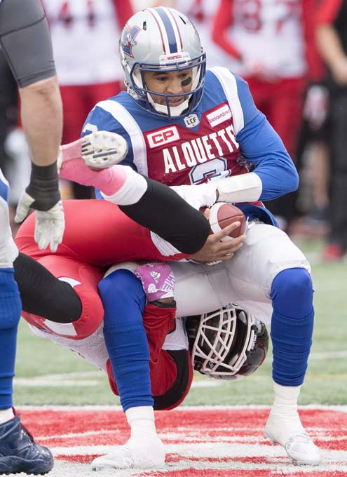 Montreal Alouettes quarterback Vernon Adams Jr., is sacked by Calgary Stampeders linebacker Charleston Hughes during first quarter CFL football action Sunday, October 30, 2016 in Montreal. THE CANADIAN PRESS/Ryan Remiorz
