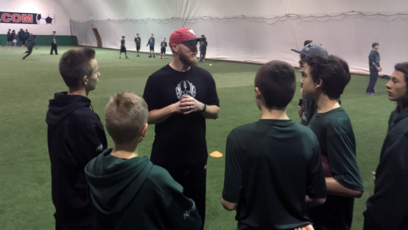2017-dave-dickenson's-passing-academy-bo-levi-mitchell-with-group-of-kids