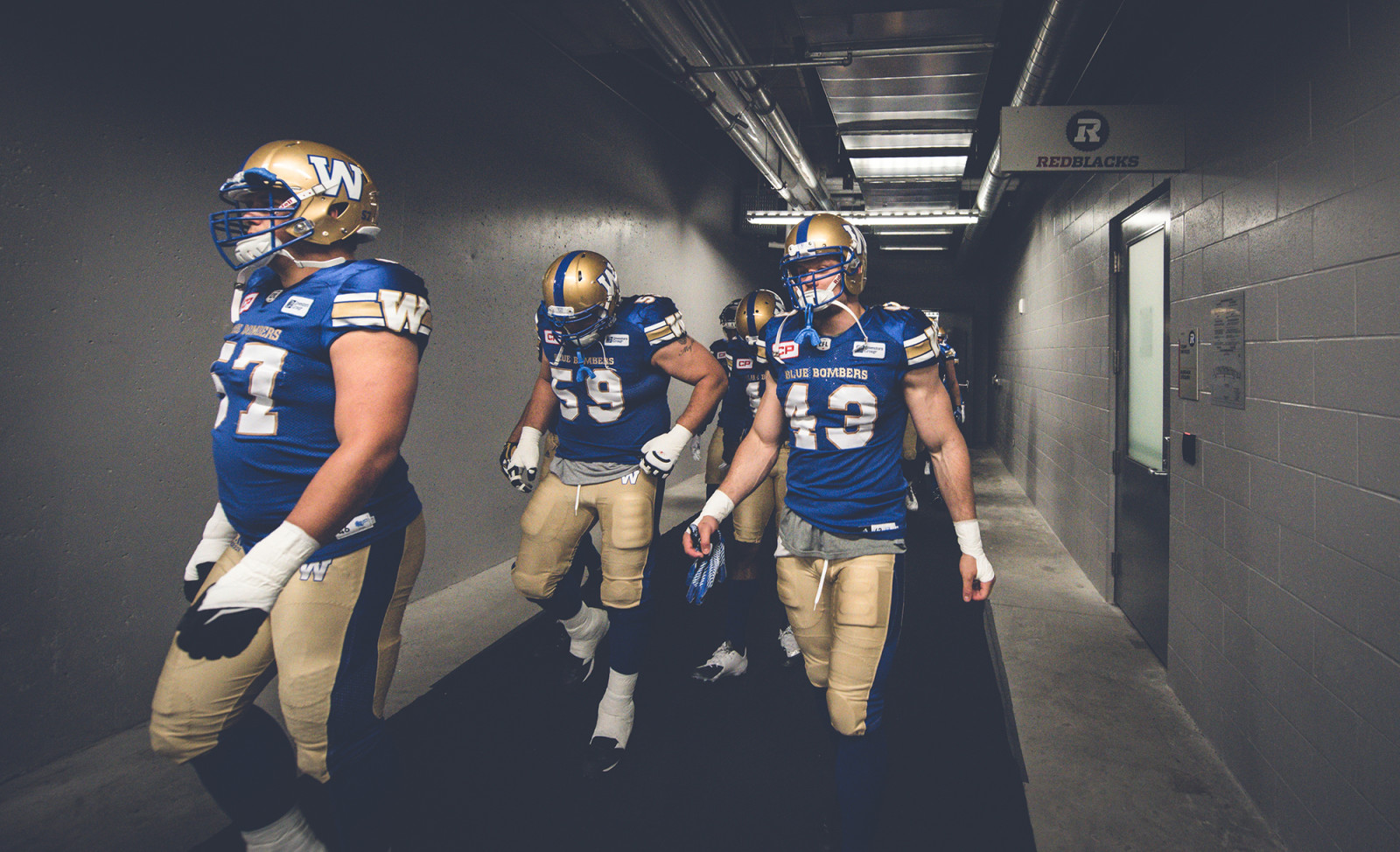 Trent Corney (43) and Jace Daniels (59) of the Winnipeg Blue Bombers during the pre-season game at TD Place in Ottawa, ON on Monday June 13, 2016. (Photo: Johany Jutras)