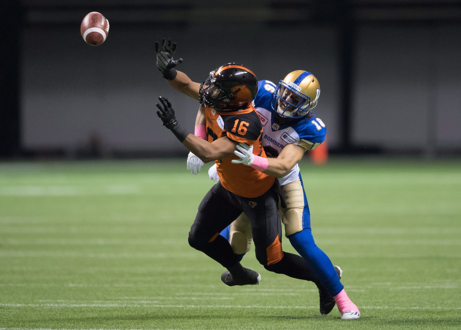 B.C. Lions' Bryan Burnham, left, fails to make the reception as Winnipeg Blue Bombers' Taylor Loffler defends during the first half of a CFL football game in Vancouver, B.C., on Friday October 14, 2016. THE CANADIAN PRESS/Darryl Dyck