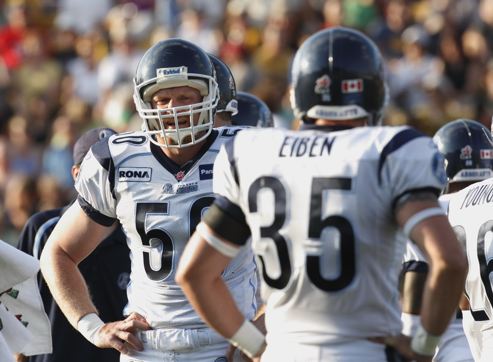 Linebackers Mike O'Shea (50) and Kevin Eiben (35) look at each other during a time out on Saturday, July 7, 2007. CFL PHOTO/K. Rodriguez