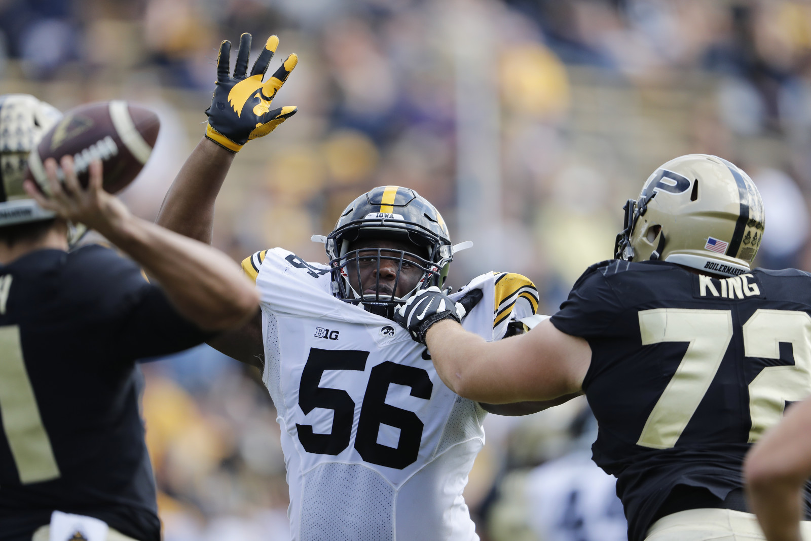 Iowa Hawkeyes defensive lineman Faith Ekakitie (56) tries to knock down a pass by Purdue Boilermakers quarterback David Blough (11) Saturday, October 15, 2016 at Ross-Ade Stadium. (Brian Ray/hawkeyesports.com)