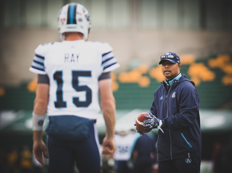 Toronto Argonauts offensive coordinator Marcus Brady and Ricky Ray (15) before the game against the Edmonton Eskimos at Commonwealth Stadium in Edmonton, AB. Saturday, November 5, 2016. (Photo: Johany Jutras)