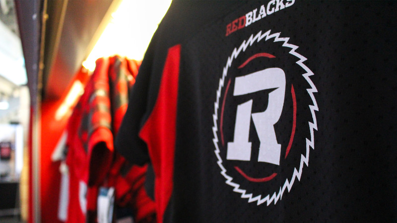 Close-iup shot of REDBLACKS merchandise