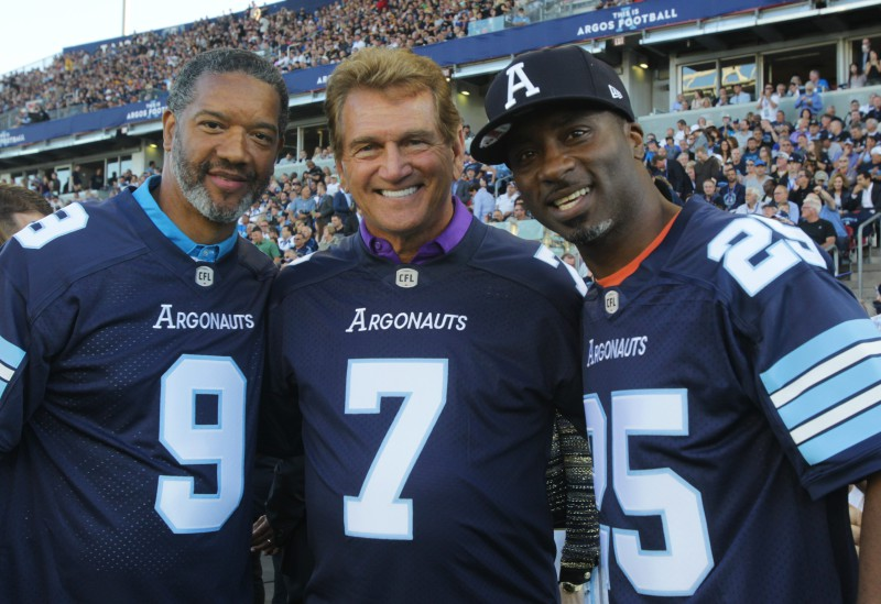 "Argos legends l-r Damon Allen, Joe Theismann and Raghib ""Rocket"" Ismail , help to open the team's new home - BMO Field during opening ceremonies before CFL action against the Ti-Cats in Toronto on Thursday, June  23, 2016.  (CFL PHOTO - Dave Chidley)"