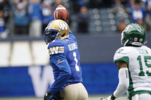 Winnipeg Blue Bombers' Darvin Adams (1) celebrates his touchdown as he runs the ball in against Saskatchewan Roughriders' Mike Edem (15) during the first half of CFL action in Winnipeg Saturday, October 13, 2018. THE CANADIAN PRESS/John Woods
