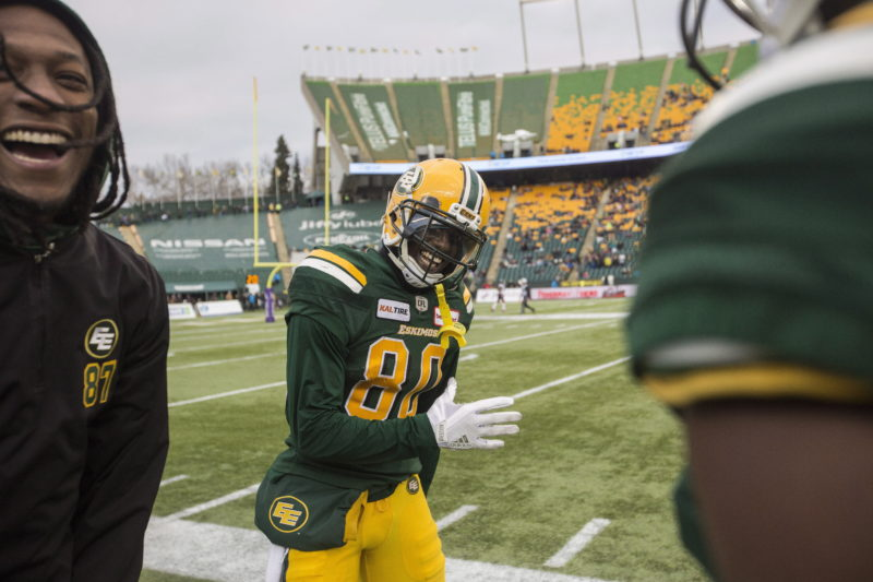 Edmonton Eskimos' Bryant Mitchell (80) celebrates his 75-yard touchdown with Derel Walker (87) during second half CFL action against the Ottawa Redblacks, in Edmonton on Saturday, Oct. 13, 2018. THE CANADIAN PRESS/Amber Bracken