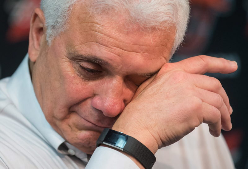 Retiring B.C. Lions head coach Wally Buono wipes away tears during an emotional final news conference as players gathered for end of season meetings and to clean out their lockers at the CFL football team's practice facility, in Surrey, B.C., on Tuesday November 13, 2018. THE CANADIAN PRESS/Darryl Dyck
