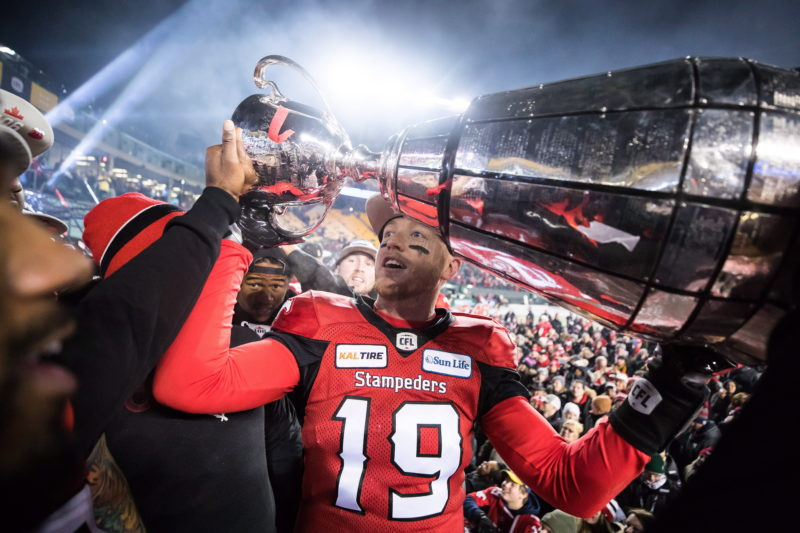 Calgary Stampeders quarterback Bo Levi Mitchell hoists the Grey Cup after defeating the Ottawa Redblacks in the 106th Grey Cup CFL championship football game in Edmonton, Alta., on Sunday November 25, 2018. THE CANADIAN PRESS/Darryl Dyck