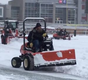 Jon Gott plows snow at TD Place ahead of REDBLACKS practice