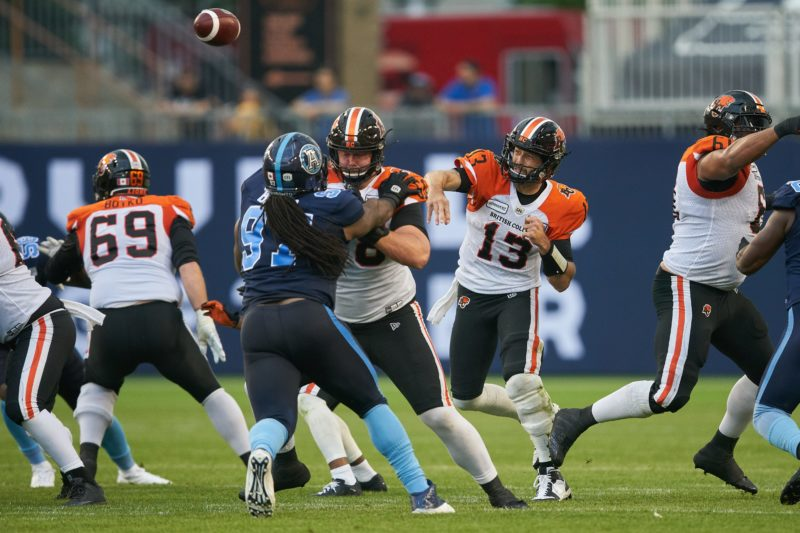 BC quarterback Mike Reilly throws the ball during first quarter CFL action between the Lion and the Toronto Argonauts in Toronto on Saturday July 6, 2019  (CFL PHOTO - Geoff Robins )