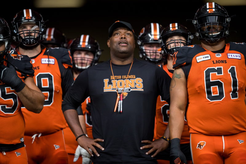 B.C. Lions head coach DeVone Claybrooks, centre, stands beside Joel Figueroa, right, before CFL football action against the Edmonton Eskimos, in Vancouver, on Thursday, July 11, 2019. THE CANADIAN PRESS/Darryl Dyck