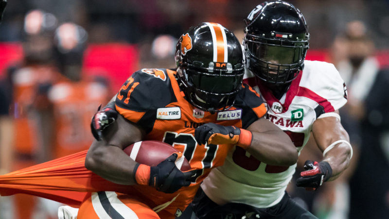 Brandon Rutley runs away from a tackle against the Ottawa REDBLACKS in Week 14. (The Canadian Press)