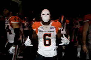 B.C. Lions' T.J. Lee, wears a mask as he and his teammates wait to be introduced before a CFL football game against the Saskatchewan Roughriders in Vancouver, on Friday October 18, 2019. THE CANADIAN PRESS/Darryl Dyck