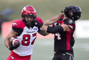 Calgary Stampeders wide receiver Juwan Brescacin fouls Ottawa Redblacks defensive back Anthony Cioffi during CFL action in Ottawa on Thursday, July 25, 2019. THE CANADIAN PRESS/Sean Kilpatrick