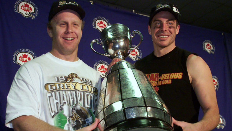 Danny McManus and Mike Morreale celebrate the Ticats' Grey Cup win in 1999 (Photo: The Canadian Press)