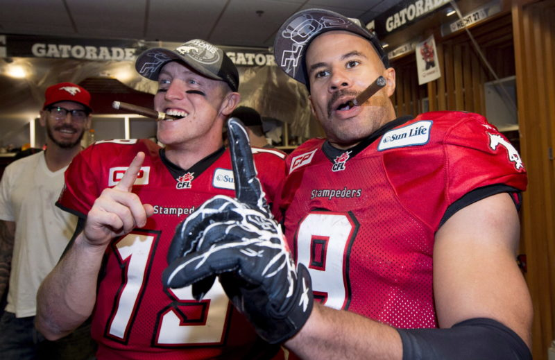 Calgary Stampeders quarterback Bo Levi Mitchell, left, and running back Jon Cornish celebrate their win over the Hamilton Tiger-Cats following the 102nd Grey Cup in Vancouver, B.C. Sunday, Nov. 30, 2014. THE CANADIAN PRESS/Nathan Denette