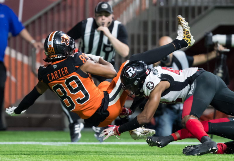 B.C. Lions' Duron Carter (89) collides with Ottawa Redblacks' De'Andre Montgomery as he makes a reception in the end zone to score a touchdown during the first half of a CFL football game in Vancouver, on Friday September 13, 2019. THE CANADIAN PRESS/Darryl Dyck