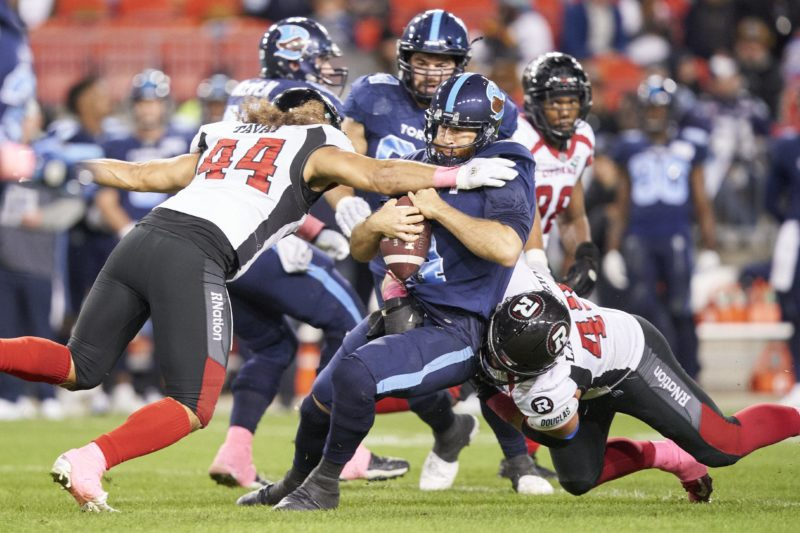 Toronto quarterback McLeod Bethel-Thompson is sacked by Ottawa's Ettore Lattanzio during fourth quarter CFL action between the Redblacks and the Argonauts at BMO Field in Toronto on Friday, October 11, 2019.  (CFL PHOTO - Geoff Robins )