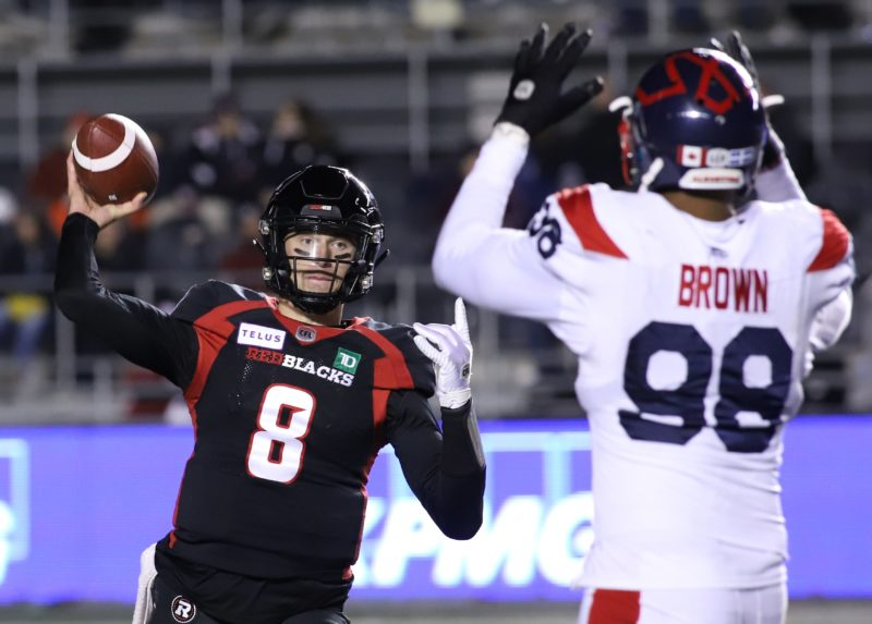 Ottawa Redblacks quarterback William Arndt (8) throws the ball as the Montreal Alouettes Ryan Brown (98) tries to block during fourth quarter CFL action in Ottawa on Saturday, November 1, 2019.  (CFL PHOTO - Patrick Doyle)