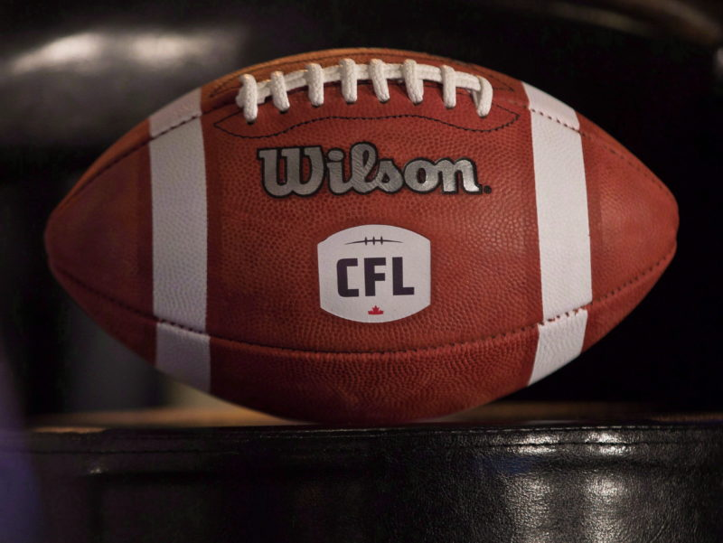 A football with the new CFL logo sits on a chair during a press conference in Winnipeg, Friday, November 27, 2015. Randy Ambrosie has been officially hired as the next commissioner of the CFL, a league source has confirmed to The Canadian Press.The source said the CFL has scheduled a news conference in Toronto on Wednesday to formally announce the appointment of the 14th commissioner in league history. THE CANADIAN PRESS/John Woods