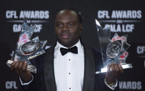 Solomon Elimimian of the BC Lions celebrates his CFL most outstanding player and most outstanding defensive player of the year during the CFL Awards in Vancouver, B.C. Thursday, Nov. 27, 2014. THE CANADIAN PRESS/Jonathan Hayward
