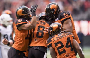BC Lions wide receiver Cory Watson (18) celebrates his touchdown with his teammates during CFL football action against the Toronto Argonauts in Vancouver on Saturday, Oct. 6, 2018. THE CANADIAN PRESS/Jonathan Hayward