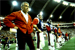 Head coach Marv Levy and Wally Buono ( right of Levy, # 39) stand on the sidelines at Montreal's Olympic Stadium.