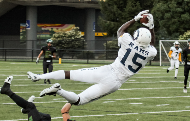The Lions Rookie of the year finalist, Jevon Cottoy, catches a pass for the Langley Rams.