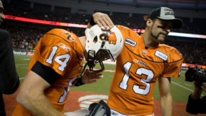 Mike Reilly and Travis Lulay embrace after defeating Edmonton in the 2011 Western Final at BC Place. Canadian Press.