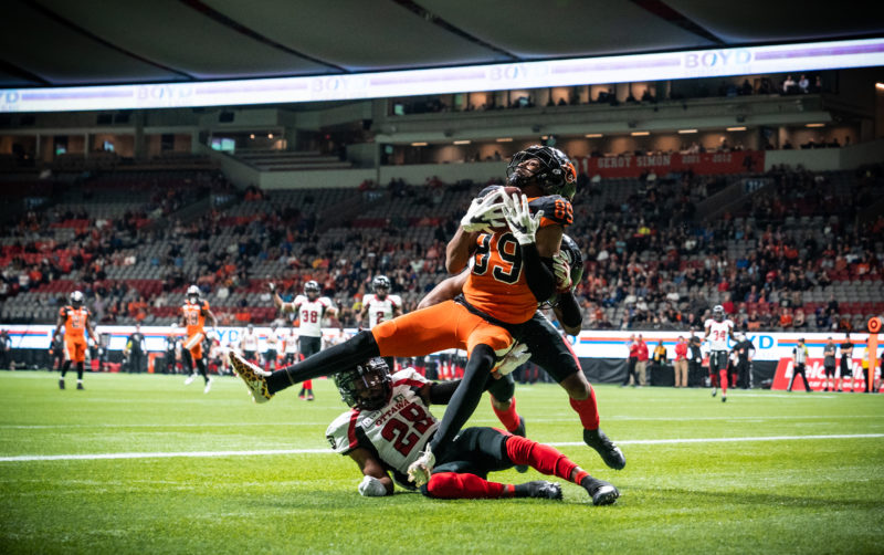 Duron Carter (89) of the BC Lions, Corey Tindal Sr. (28) and De'Andre Montgomery (41) of the Ottawa RedBlacks during the CFL game between the Ottawa RedBlacks and the BC Lions at BC Place Stadium in Vancouver, BC, Friday, Sept. 13, 2019. (Photo: Johany Jutras / CFL)