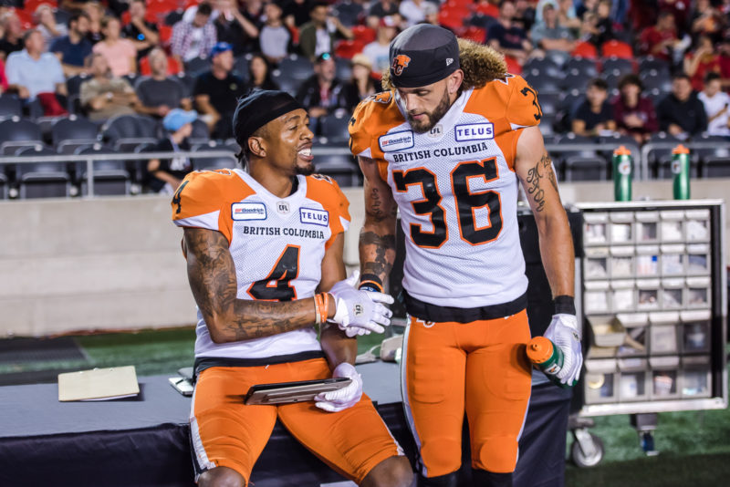 Garry Peters and Aaron Grymes during a BC Lions victory in Ottawa in 2019. Photo: Roch Lambert/Marc Bourget.