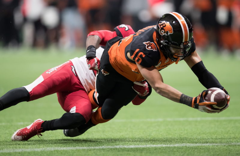 B.C. Lions' Bryan Burnham (16) dives for the goal line and scores a touchdown as Calgary Stampeders' Brandon Smith, back, defends during second half CFL football action in Vancouver, Saturday, Nov. 2, 2019. THE CANADIAN PRESS/Darryl Dyck