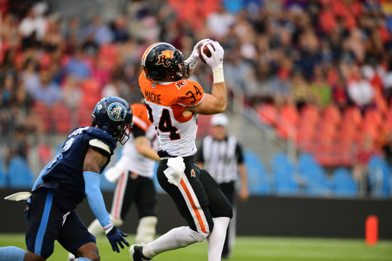 David Mackie of the BC Lions catches a pass from Mike Reilly in Toronto.