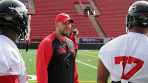 Defensive line coach Corey Mace during 2016 training camp (Photo by Geoff Crane)